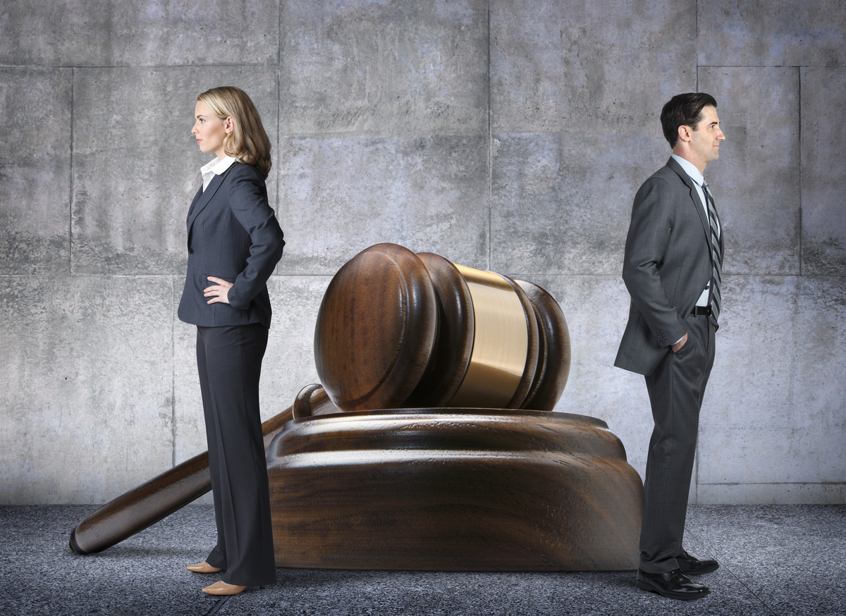 Man And Woman With Opposing Legal Points Of View